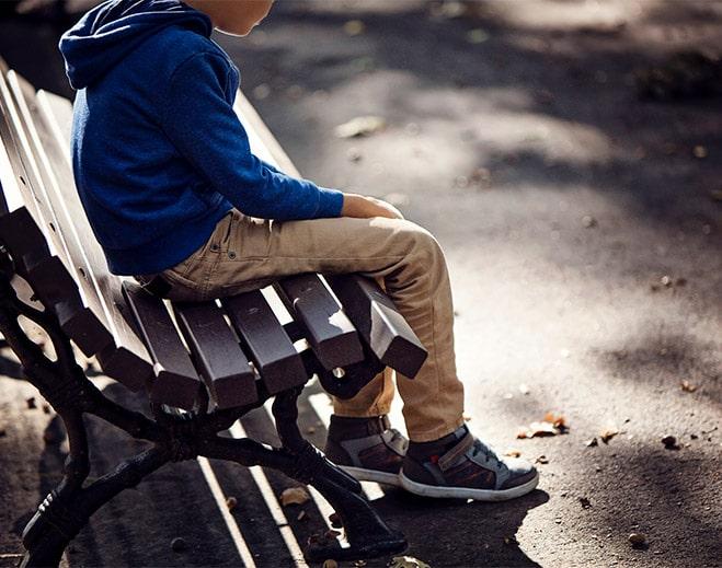 Boy Sitting on bench